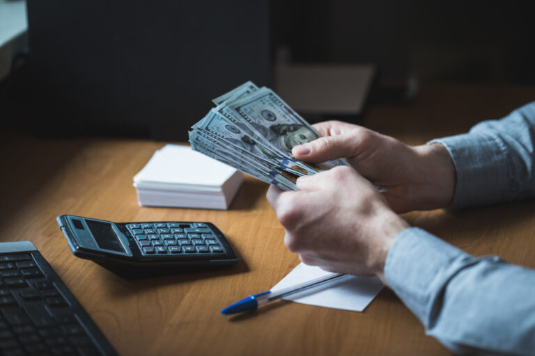 A businessman counting money. Manage your cash well